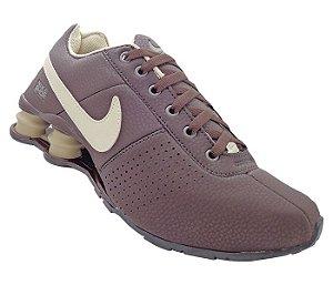 1e8c440d60 Tênis Nike Shox Deliver Marrom e Creme