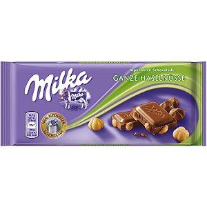 Milka Ganze Haselnüsse chocolate ao Leite com avelãs 100g