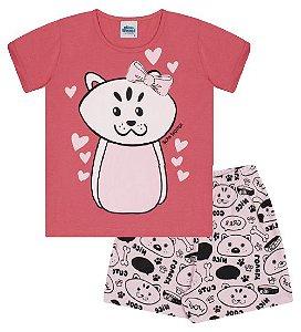 Pijama cor coral com estampa de gatinha que brilha no escuro