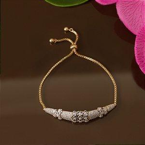 Pulseira dourado em forma de gota com detalhes florais e cravação em zircônias