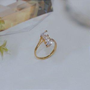 Anel dourado com cristal transparente