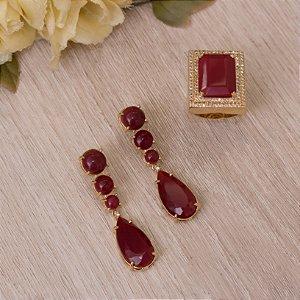 Anel dourado com cristal rubi