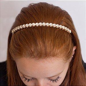 Tiara dourada cravejada com pedra cristal