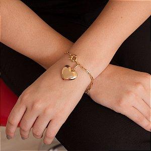 Pulseira dourada com elos e pingente de coração com zircônias