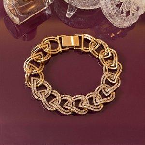 Pulseira dourada com elos cravejados com micro zircônias cristais