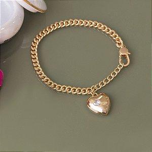 Pulseira dourada formato de coração de cristal