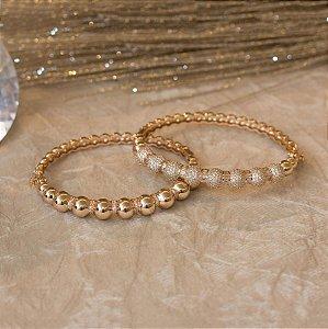 Bracelete dourado cravejado com zircônias e navetes cristais