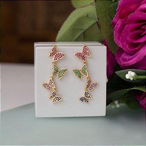 Brinco de borboleta cravejado com cristais coloridos