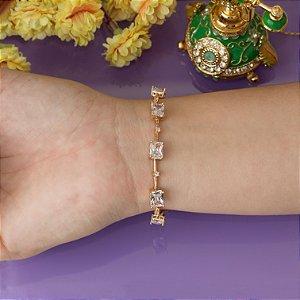 Pulseira dourada com cristais transparentes