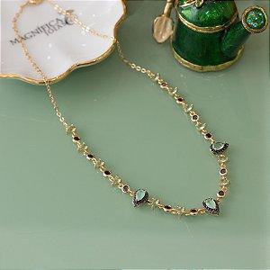 Colar dourado com gotas de cristal aqcua marine e cravação em zircônias negras