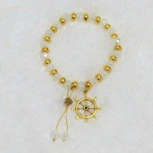 Pulseira VIBE, dourada, leme - REF P059