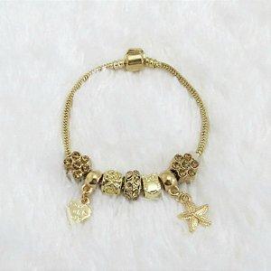 Pulseira inspired, estrela do mar, 5 berloques + 2 pingentes, dourada - 17,5cm -  - REF P240