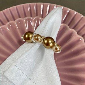 Kit com 4 porta guardanapos com esferas de pérolas douradas.