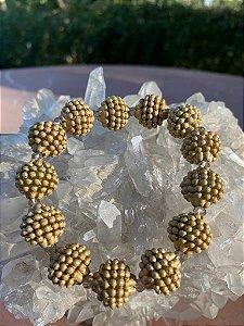 Pulseira de peças indianas cor ocre e detalhes de cristais tchecos lapidados translúcidos.