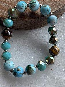 Pulseira mista esferas de vidro (tipo murano) turquesa , cristais lapidados, pedra olho de tigre e entremeios de metal banhado.