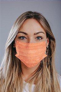 Máscara cirúrgica tripla c/ elástico cx. c/ 50 und. LARANJA