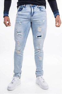 Calça jeans destroyed austin super skinny
