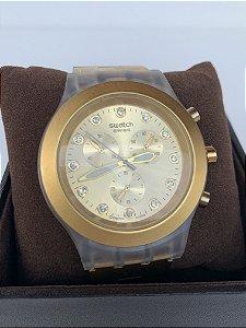 Relógio suíço dourado