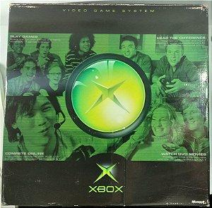 Xbox Clássico na caixa com 3 jogos