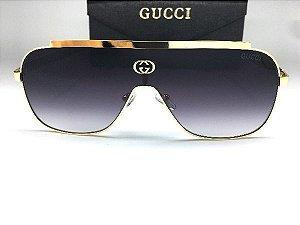 Óculos de Sol GG Gucci Máscara - Lente  Preto Deagrade /  Armacao Dourada
