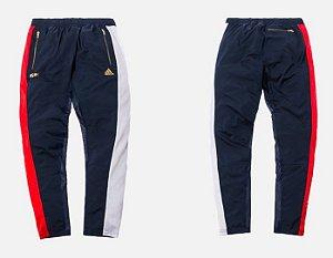 ENCOMENDA - KITH x Adidas - Calça Asymmetrical Windpant