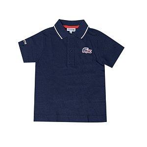 "LACOSTE - Camisa Polo USA Flag ""Azul"" (Infantil) -USADO-"