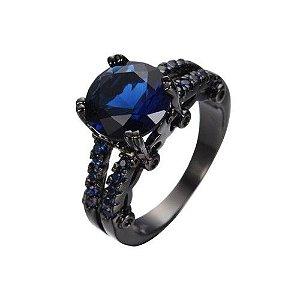 Anel Preto Solitario Ouro Negro com Topazio Safira Cravejado de Zirconias Azuis Coleção Joias da Princesa