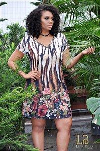 Vestido animal print com barrado floral, decote bordado e detalhe de amarrar na costa.