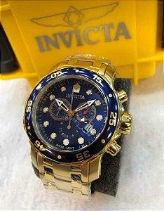 Relogio Invicta Pro Diver dourado com mostrador azul