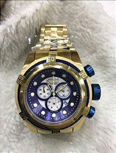 Relogio Invicta Zeus dourado fundo azul cronografo