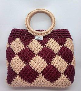 Bolsa Adele, modelo de mão, em crochê, nas cores bordô e rosê, feita com fio náutico de polipropileno
