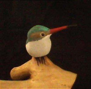 Miniatura madeira Beija-Flor na raiz