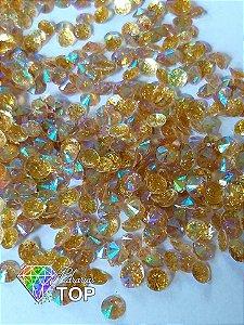 Chaton rivoli c/ glittler dourado 4mm - Aprox. 30 pcs