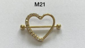 mamilo folheado dourado com pedra direito