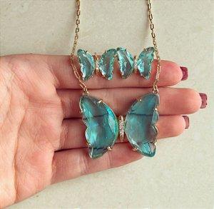 Conjunto Eos Luxuoso Maxi Borboleta Cristal Azul Claro e Zircônias Diamond Dourado