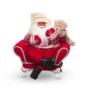 Papai Noel com ursinho na poltrona