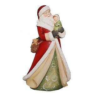 Papai Noel segurando criança