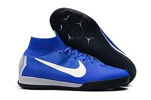 9a695cc22e57c Chuteira Nike Futsal Cano Alto Superfly X VI Elite Branca e laranja ...