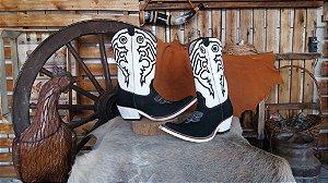 Bota texana cano normal bico fino aladim inclinado solado em eva branco couro preto