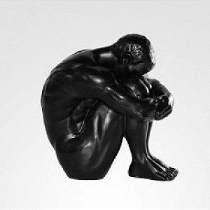 Escultura Homem agachado