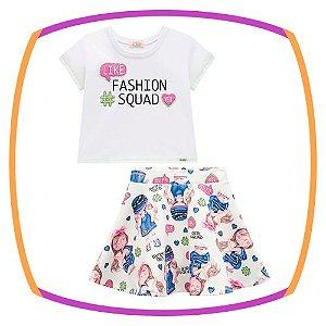 Conjunto infantil Boxy em meia malha (FASHION SUQASH) e saia em fly tech estampada com shorts embutido