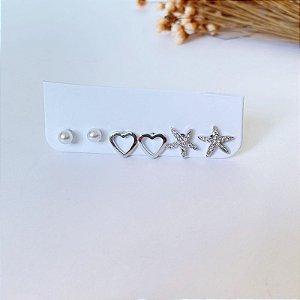 Kit de brincos pequenos estrela do mar cravejada, coração liso e mini pérola prata