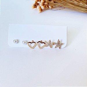 Kit de brincos pequenos estrela do mar cravejada, coração liso e mini pérola dourada