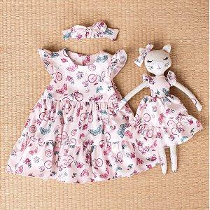 Vestido de bebê Petit Cherie natural orgânico faixa bicicleta rosa
