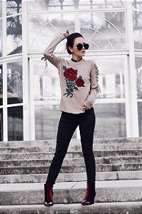 Blusa em tricot com rosa