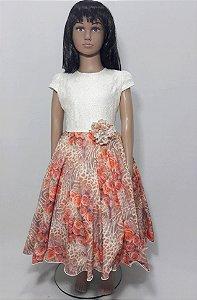 Vestido infantil busto branco , com saia estampada com det flor na cintura