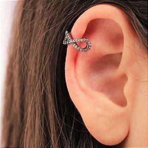 Piercing Fake com símbolo do infinito pequeno
