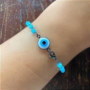 Pulseira miçangas azuis e olho grego