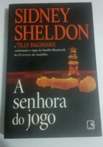 A senhora do jogo - Sidney Sheldon (marcas de uso)