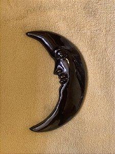 Lua em bronze escurecido